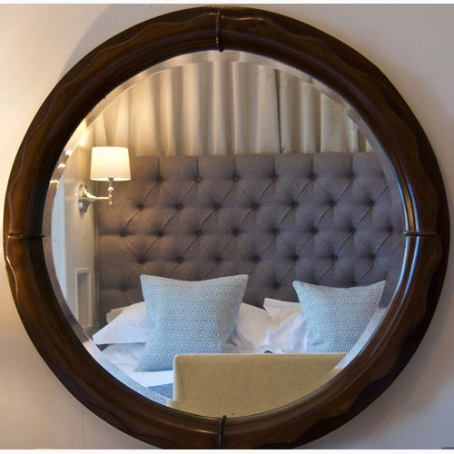 Reflection of bedroom in a mirror